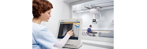 Digital Diagnost nurse clinically checking xray